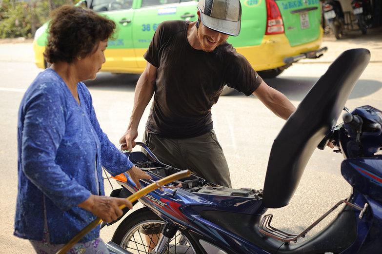 Tyler & Vietnamese Lady Filling Gas Tank