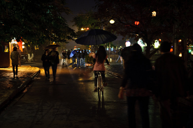 Rainy Night Cyclist in Hội An