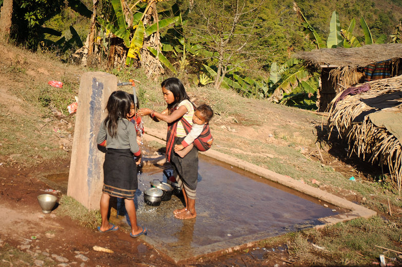 Lao Villagers at the Water Spigot