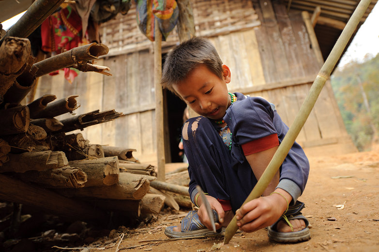 Lao Boy Making Bow & Arrow