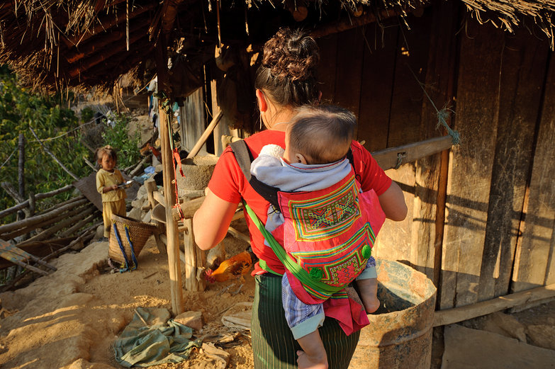 Lao Mom & Baby Grinding Corn