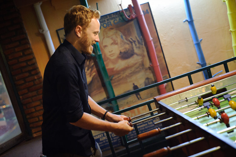 Tyler Playing Foosball