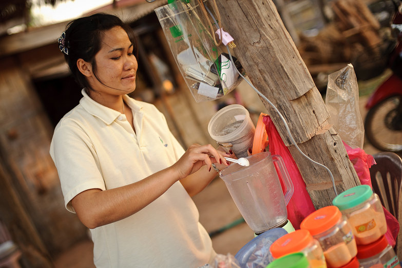 Lao Woman Making Smoothie