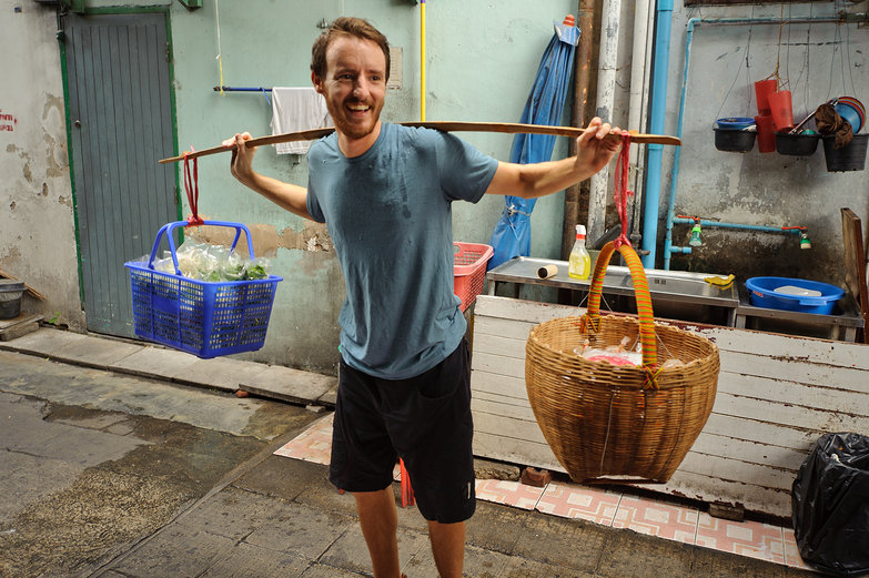 Guy Carrying Baskets