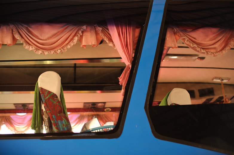Blue Thai Bus with Frilly Pink Curtains