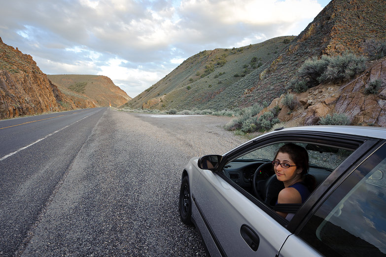 Tara in the Driver's Seat on Nevada's Loneliest Road at Dusk