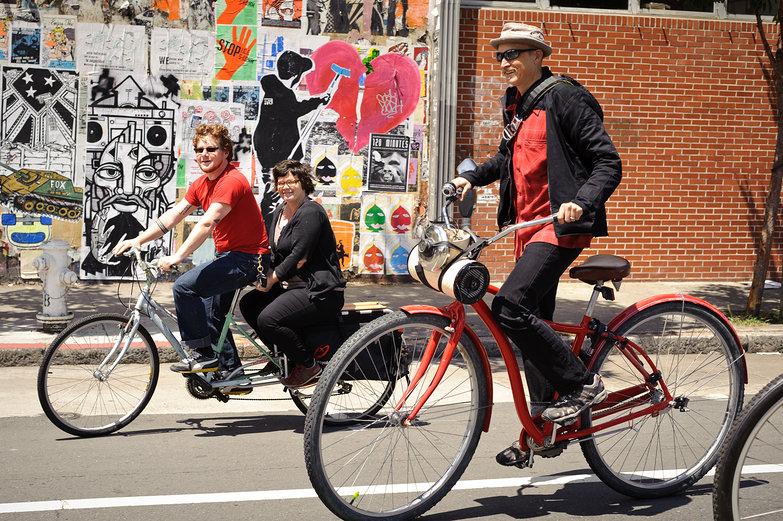 Max & Manjula Biking Next To ENORMOUS Bicycle