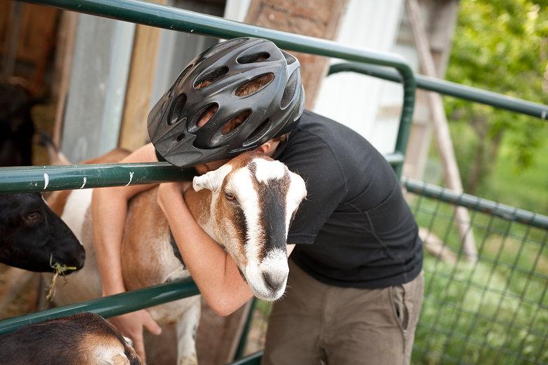 Tyler Hugging Goat