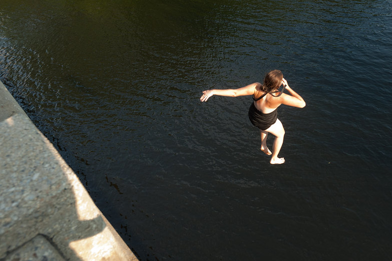 Tara Jumping off a Bridge into the Saco River