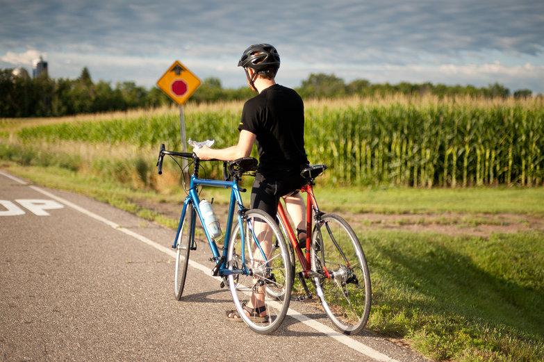 Tyler Holding the Bikes