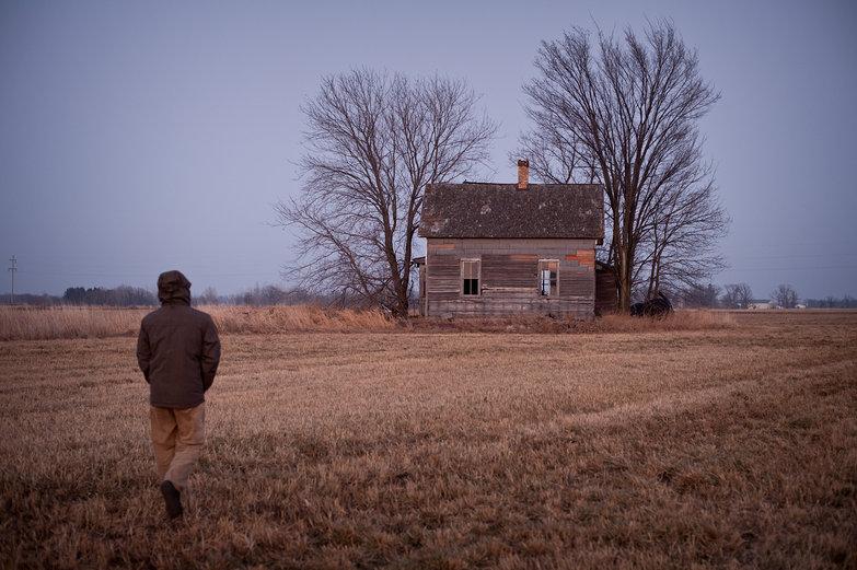 Tyler in Field, Walking Toward Abandoned House
