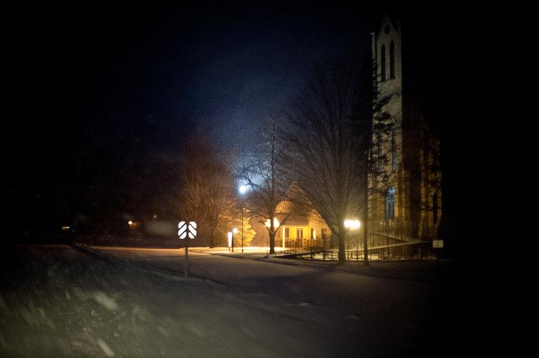 Snowy Drive Past Church