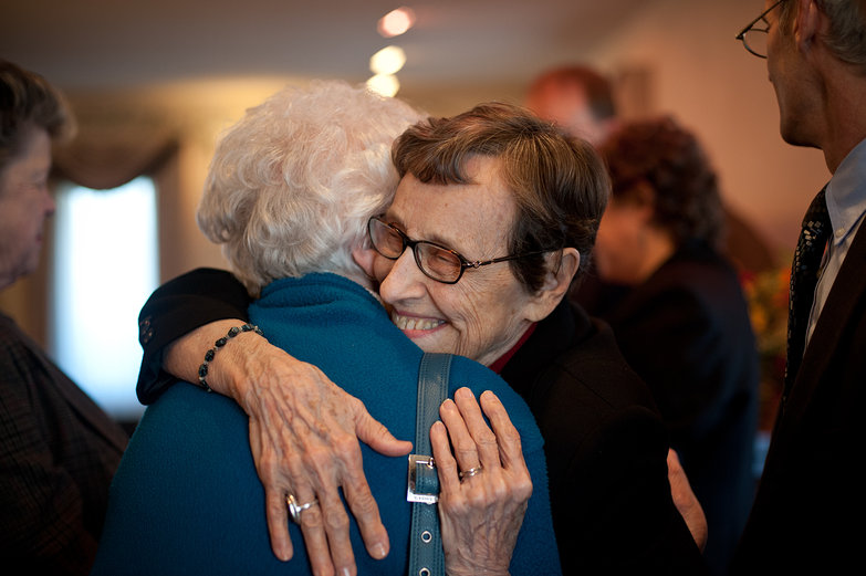 Grandma Hugging a Friend