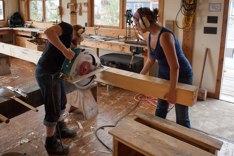 Us Working at North House Folk School Timber Framing Workshop