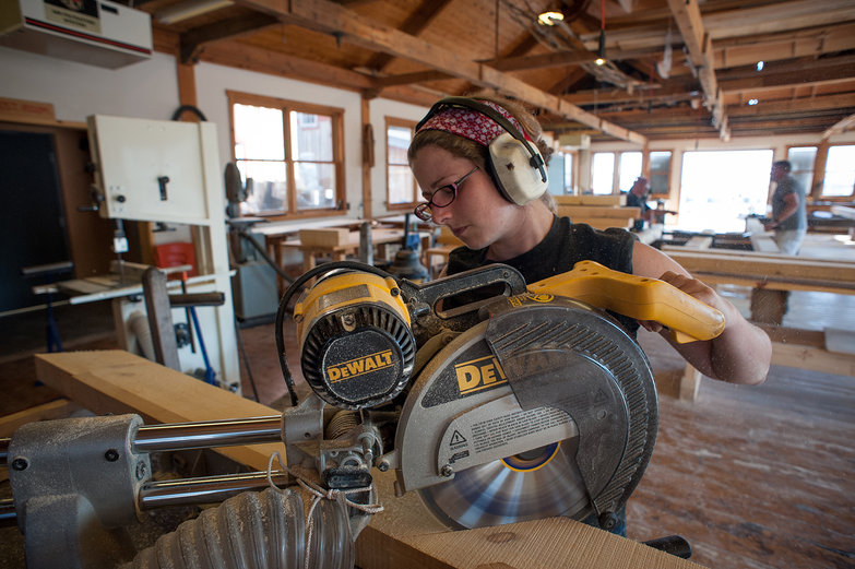 Tara Cutting Knee Braces on Combination Miter Saw