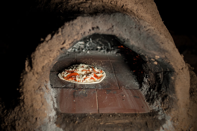 Pizza Baking in Earthen Oven