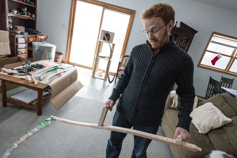 Tyler Holding Grass Blade Scythe