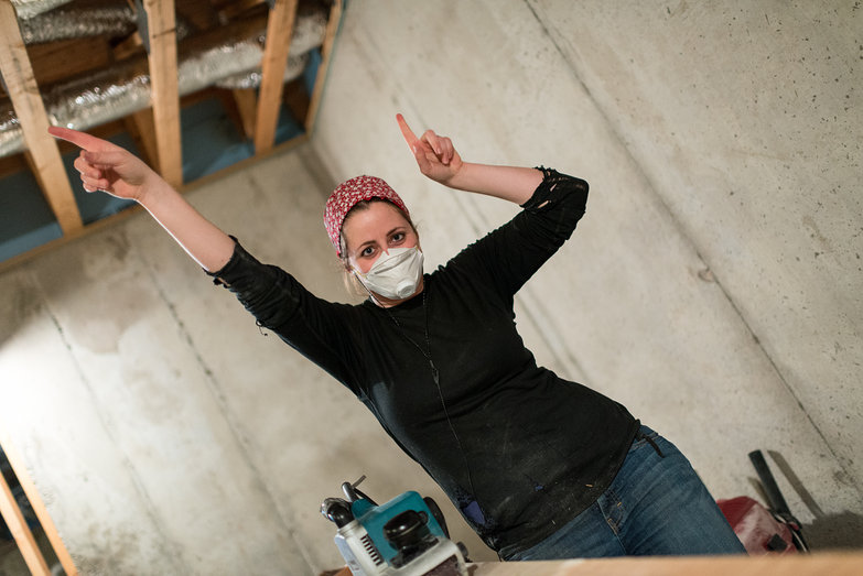 Tara Dancing While Sanding Timber Frame