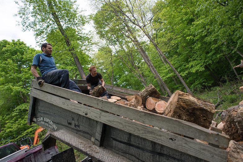 Tyler & David Unloading Wood