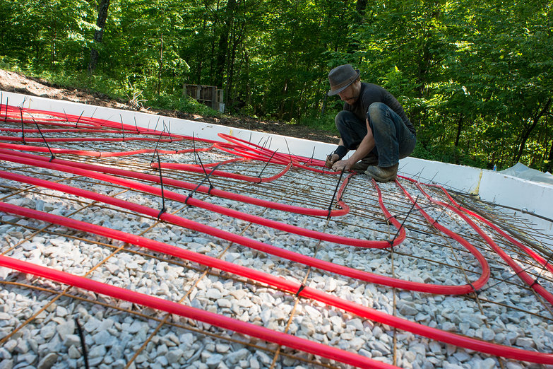 Tyler Affixing Radiant Heat Tubing to 6x6 Wire Mesh