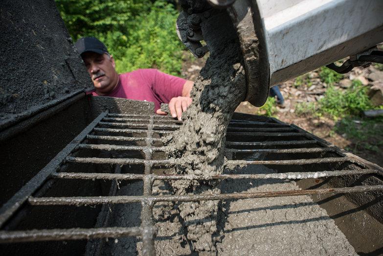 Concrete Pouring into Pump Truck Hopper
