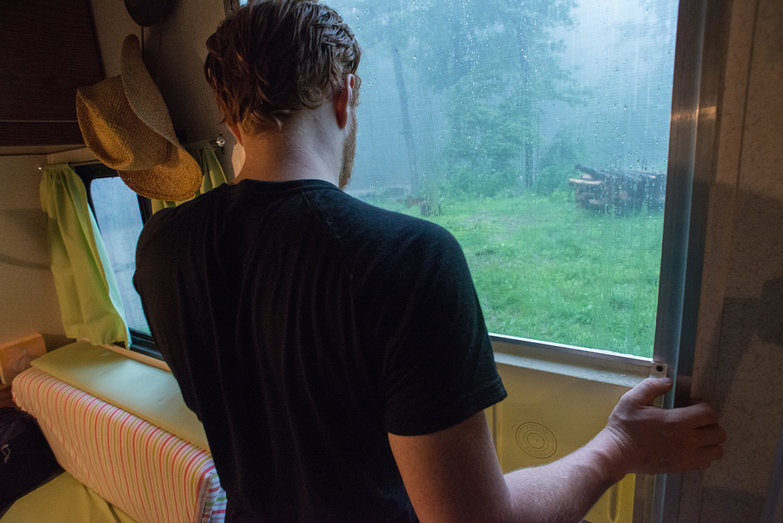 Tyler Watching the Rain From Our Camper