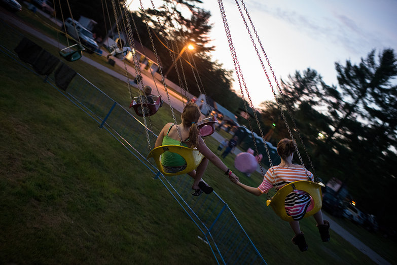 Girls Holding Hands on Ossipee Valley Fair Swing Ride