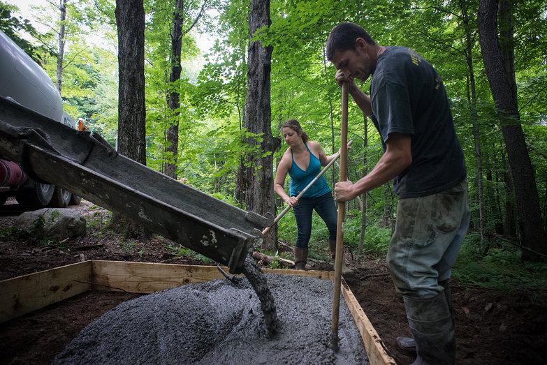 Tara & Chris Spreading Concrete