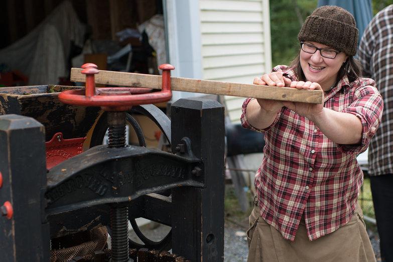 Jenna Pressing Apples in Cider Mill