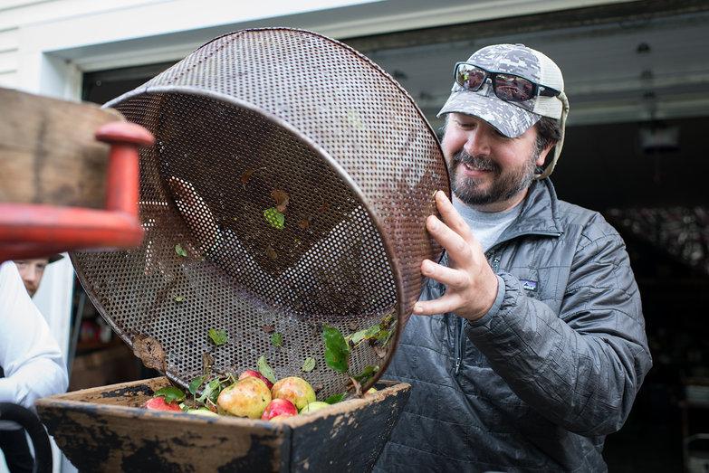 Jeremy Loading Apples into Cider Mill Hopper