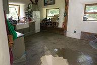 Applying Oil Mixture on Earthen Floor