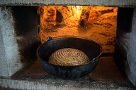 Bread Baked in Cast Iron Kettle in Hearth Oven