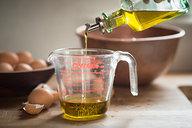 Measuring Olive Oil for Orange & Anise Olive Oil Cake